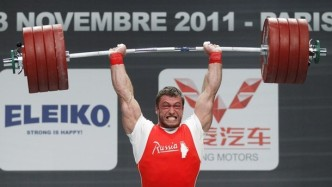 Dmitry Klokov of Russia competes in the men's 105kg weightlifting competition during the World Weightlifting Championships at Disney Village in Marne-la-Vallee outside Paris, November 12, 2011. REUTERS/Benoit Tessier (FRANCE - Tags: SPORT WEIGHTLIFTING)